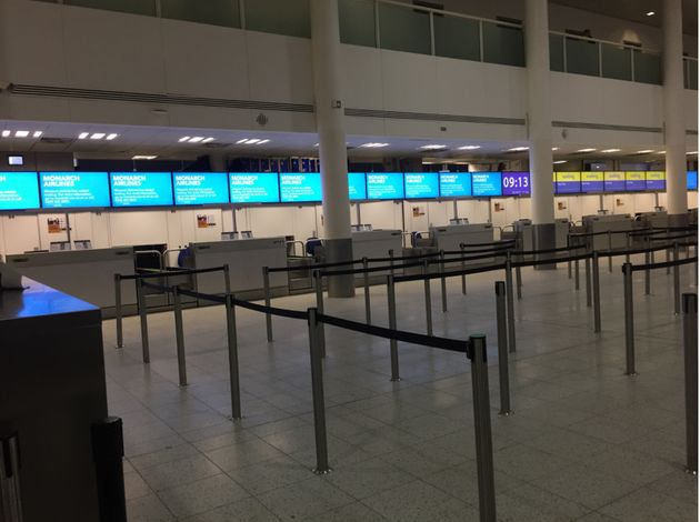 Deserted Monarch check in desks at Gatwick Airport just hours after the company's collapse was