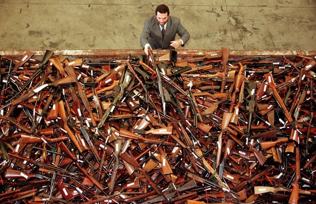 Mick Roelandts, firearms reform project manager for the New South Wales Police, looks at a pile of about...