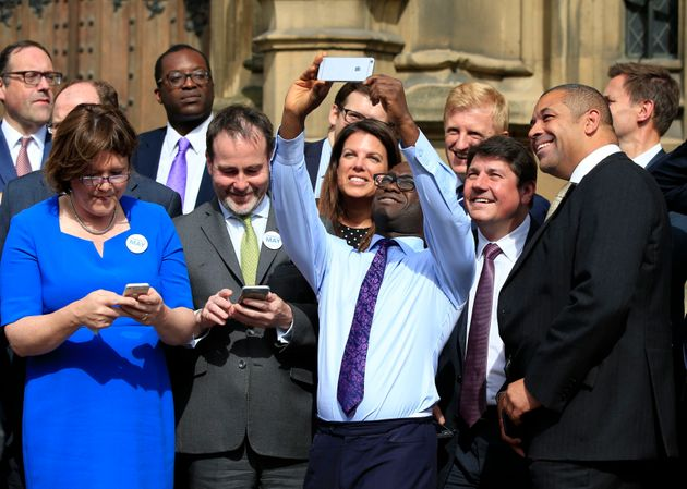 Sam Gyimah taking a selfie with other Tory