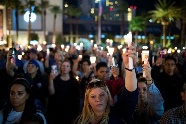 Mourners at a vigil in Las Vegas after 59 people were killed a gun