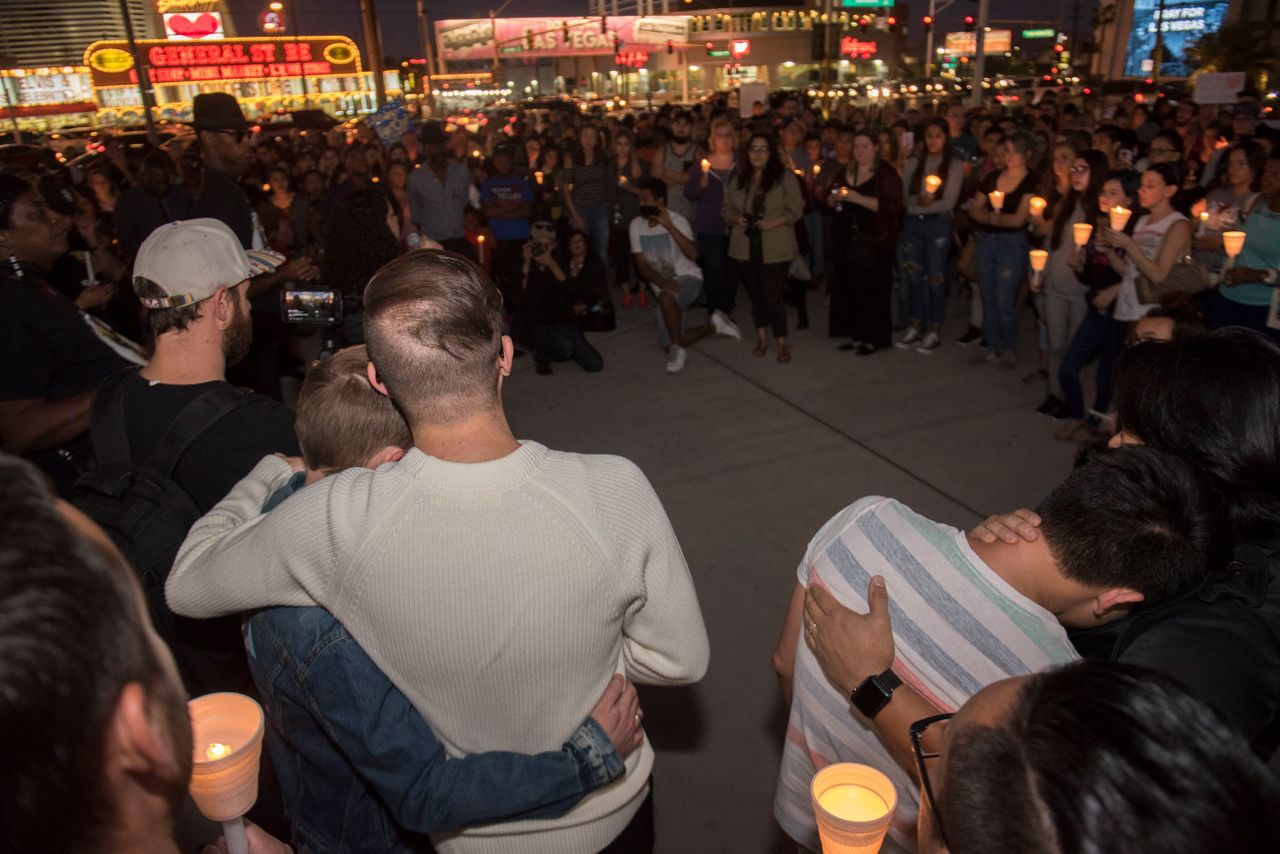People comfort each other during the vigil.