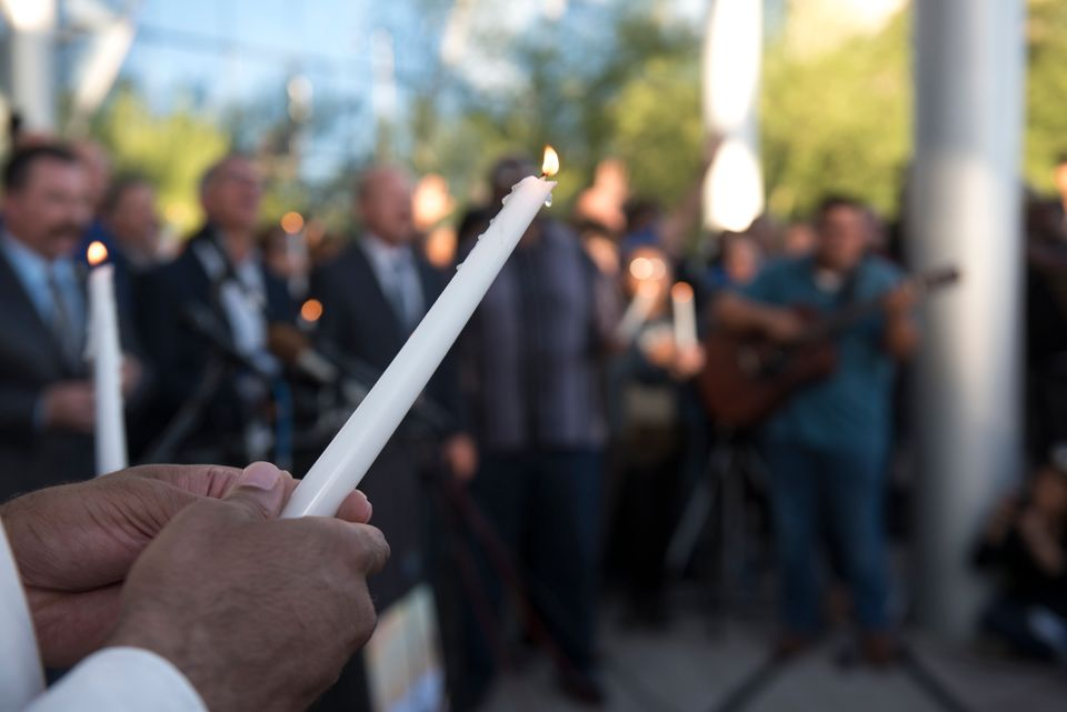 Candles are lit during a vigil held at Las Vegas City Hall.