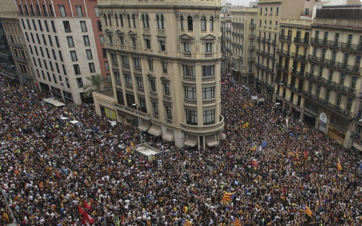 People gather to stage a demonstration within the general strike, supporting Catalonian independence and reacting against Spa