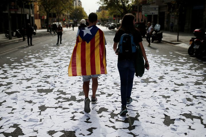 People gather to stage a demonstration within the general strike, supporting Catalonian independence,