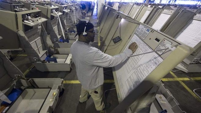 A technician prepares voting machines to be used in last year's election in Philadelphia. Many state and local governments ha