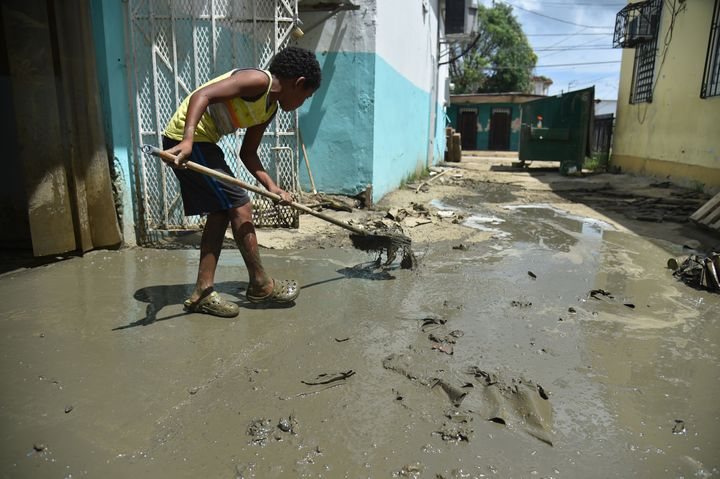 A child helps clean-up efforts in Toa Baja on Oct. 2, 2017.