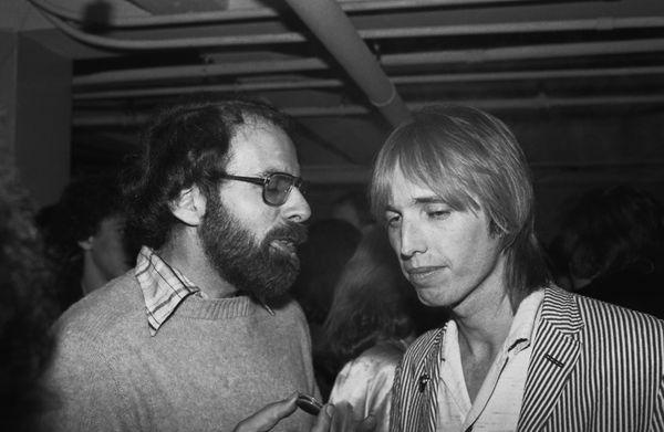 Chattingwith Los Angeles Times pop critic, Robert Hilburn, backstage at a 1980 Santa Cruz, CA.