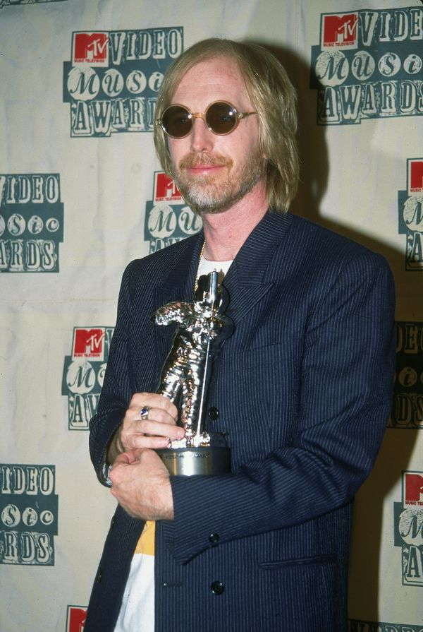 "Holding an MTV Video Music Award for Best Male Video (for the song ""Mary Jane's Last Dance"") on Sept. 8, 1994."