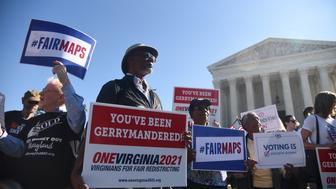 WASHINGTON, DC - OCTOBER 03: Demonstrators gather outside of The United States Supreme Court during an oral arguments in Gill v. Whitford to call for an end to partisan gerrymandering on October 3, 2017 in Washington, DC. (Photo by Olivier Douliery/Getty Images)