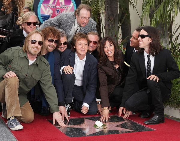 With Sir Paul McCartney, Olivia Harrison, Tom Petty, Jeff Lynne, Jim Keltner, Joe Walsh and Dhani Harrison at the ceremo