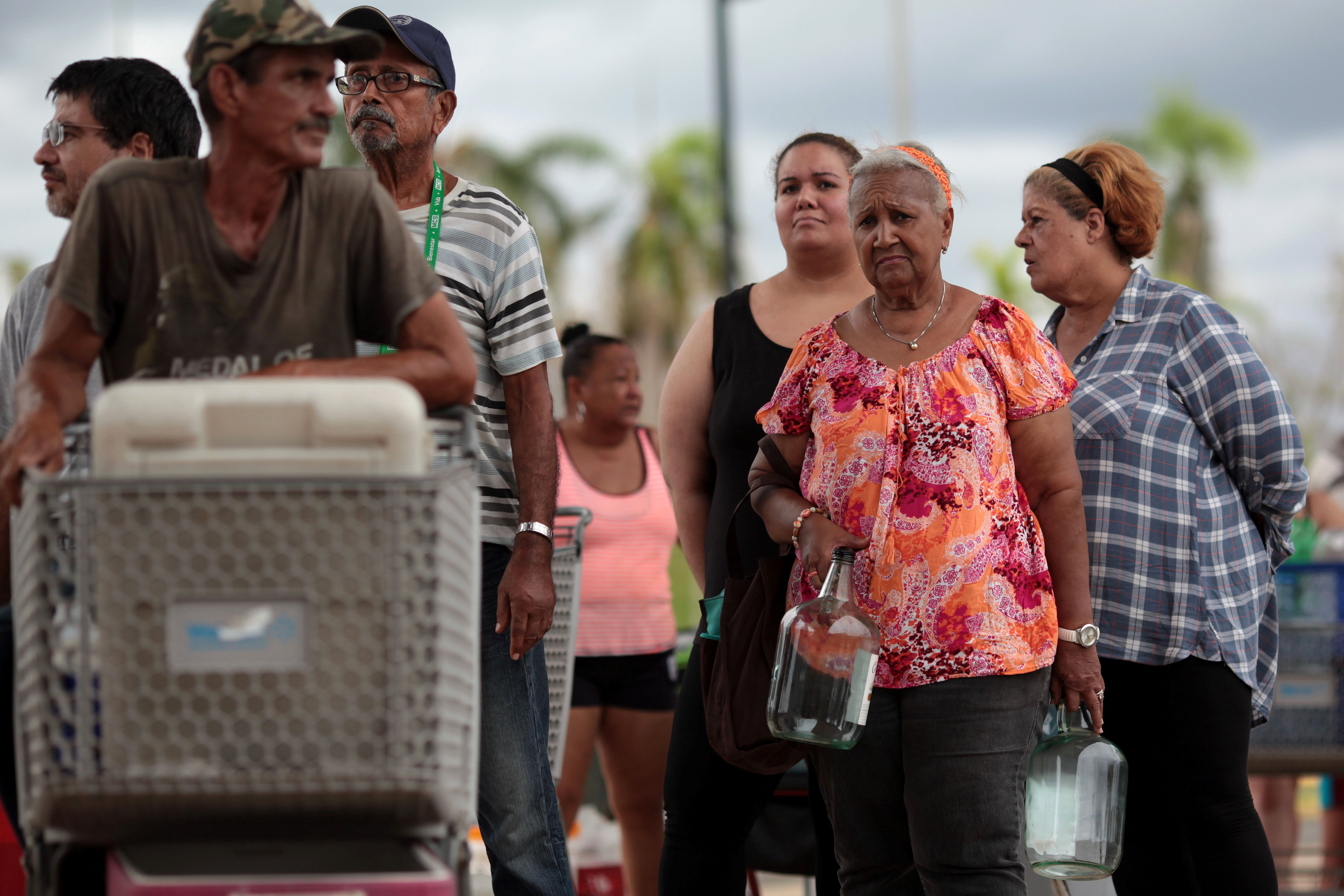 Local residents wait in line during a water distribution in Bayamon following damages caused by Hurricane Maria in Carolina, Puerto Rico, September 30, 2017  REUTERS/Alvin Baez