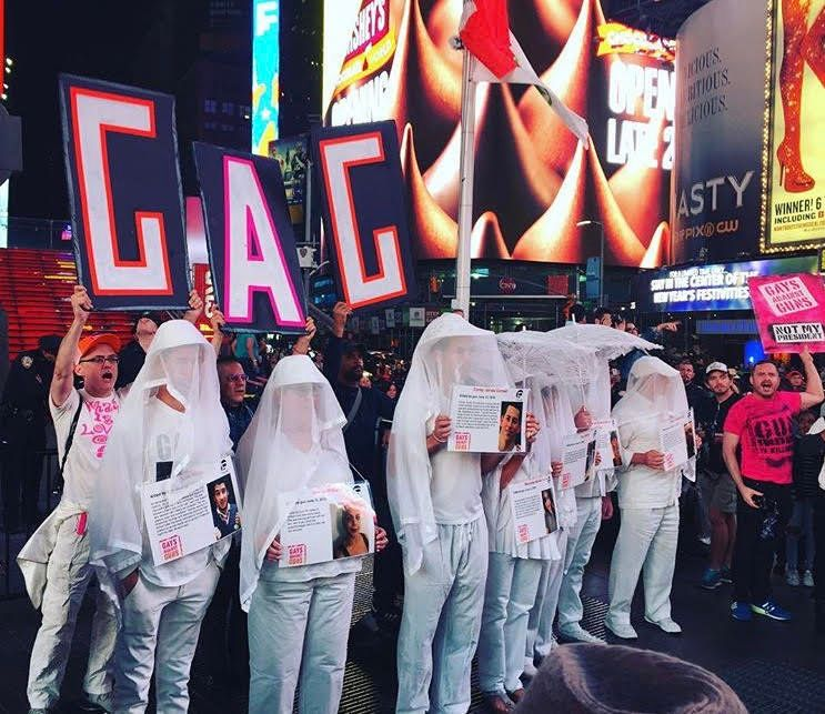 More than 100 Gays Against Guns (GAG) protesters marched from New York's Union Square to Times Square Monday in hon
