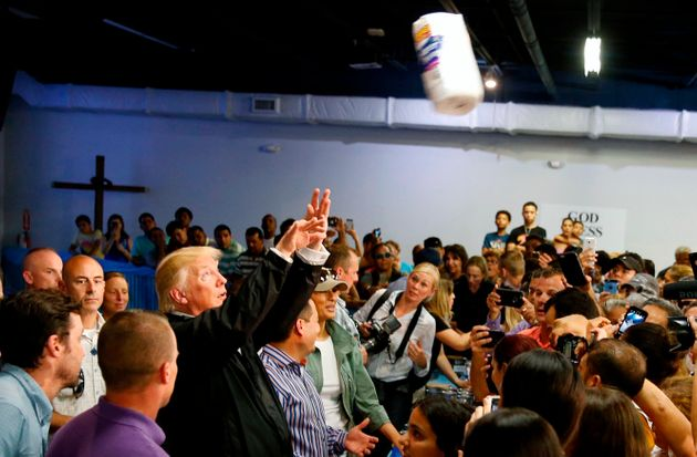 President Trump chucks rolls of paper towels into a crowd of local residents at Calgary Chapel in San...