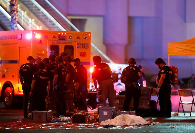 First responders gather near a victim of the mass shooting in Las Vegas on Oct. 1,