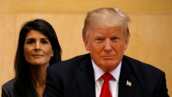 U.S. Ambassador to the UN Nikki Haley (L) and U.S. President Donald Trump participate in a session on reforming the United Nations at UN Headquarters in New York, U.S., September 18, 2017. REUTERS/Kevin Lamarque