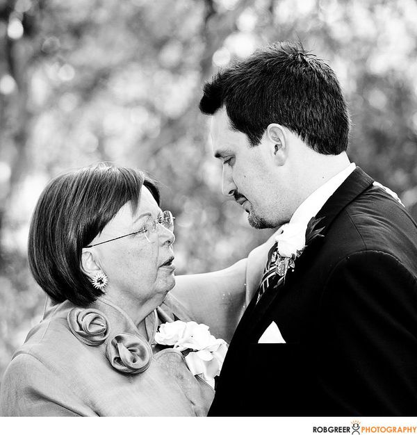 """""""This image shows a simple moment between a mother and her son during their reception dance. But I was crying as I took it, a"""