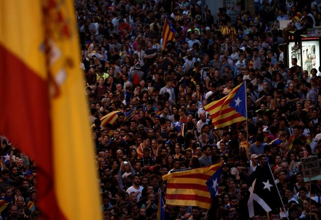 People gather at Spanish police headquarters to stage a demonstration, supporting Catalonian independence...
