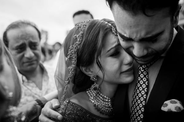 """""""Vinita hugging her brother (with her father in the background) after her wedding ceremony. It's a traditional part of the Si"""
