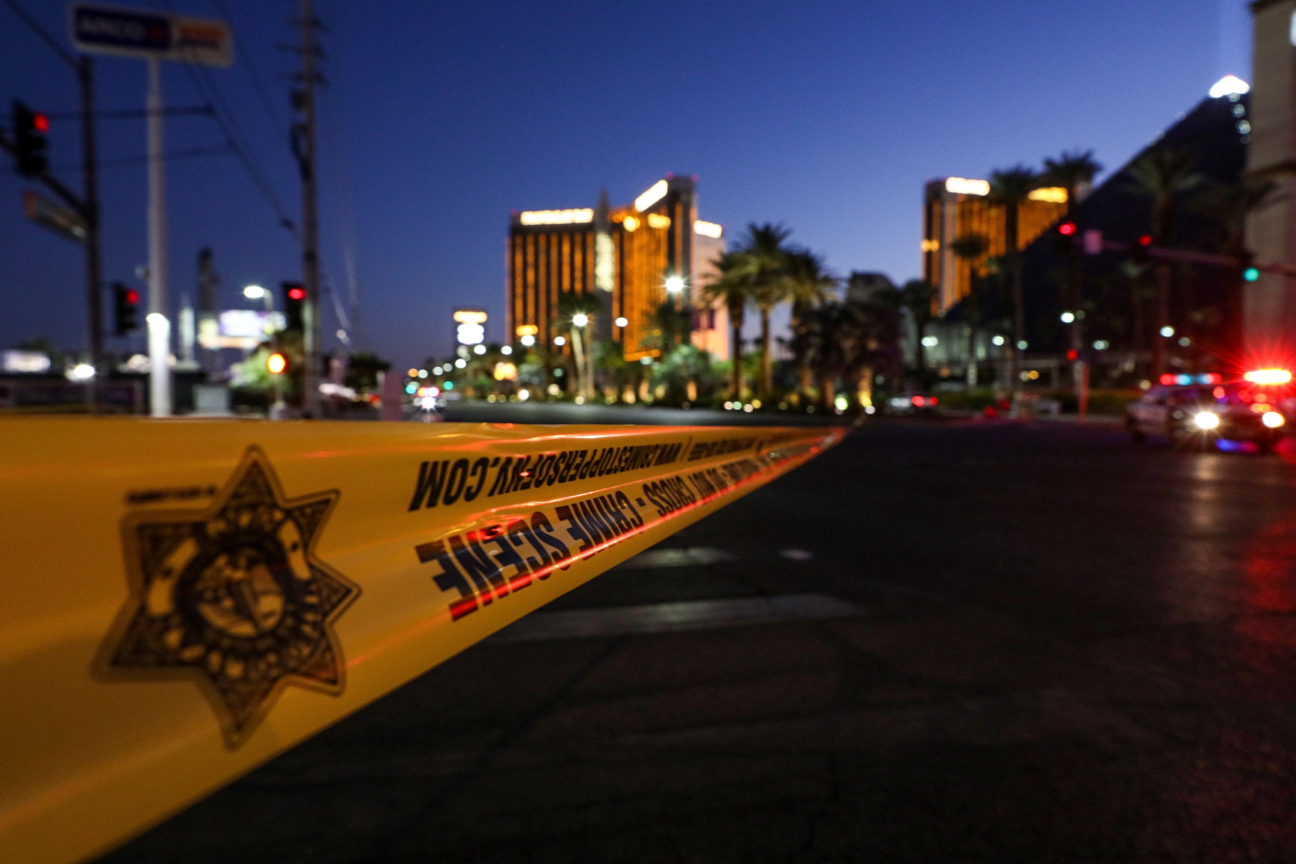 LAS VEGAS, USA - OCTOBER 02: Police block the roads leading to the Mandalay Hotel (background) and inspect the site after a gunman attack in Las Vegas, NV, United States on October 02, 2017. At least 59 people were killed and more than 527 others wounded at a country music concert in the city of Las Vegas late Sunday night in the mass shooting. A gunman -- identified as Stephen Paddock -- opened fire on more than 10,000 concert-goers at an outdoor venue from across the Mandalay Bay Hotel at around 10.08 p.m. local time (0508GMT Monday), Clark County Sheriff Joseph Lambardo from the Las Vegas Metropolitan Police Department (LVMPD) told reporters.  (Photo by Bilgin S. Sasmaz/Anadolu Agency/Getty Images)