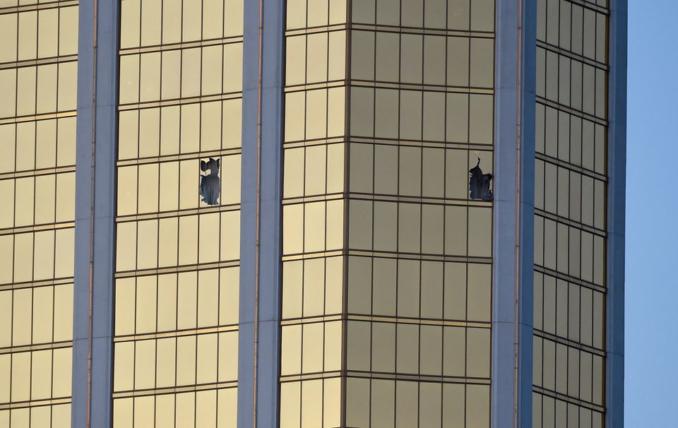 Broken windows are seen on the 32nd floor of the Mandalay Bay Resort and