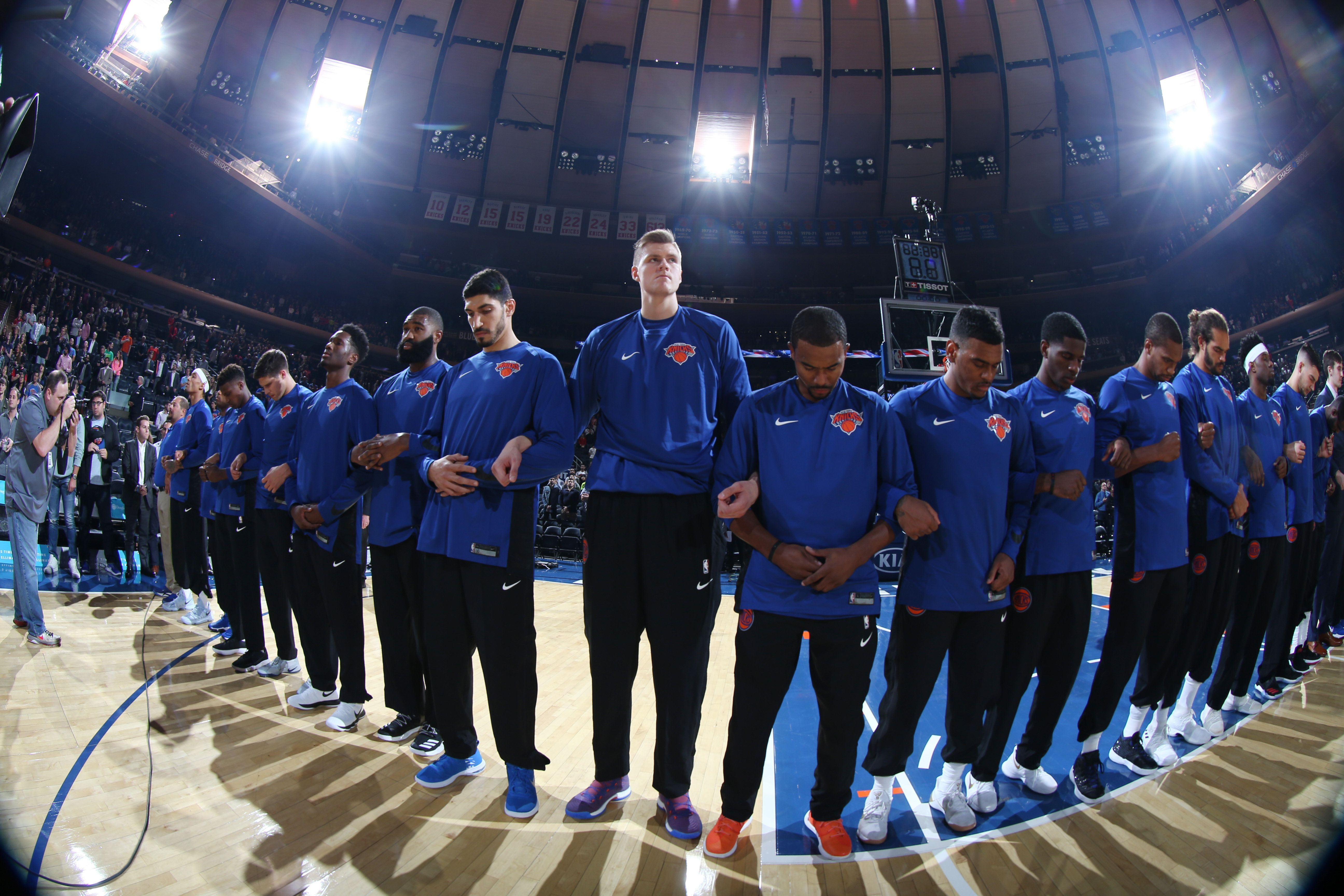 NEW YORK, NY - OCTOBER 3:  The New York Knicks stand for the National Anthem before the preseason game against the Brooklyn Nets on October 3, 2017 at Madison Square Garden in New York City, New York.  NOTE TO USER: User expressly acknowledges and agrees that, by downloading and or using this photograph, User is consenting to the terms and conditions of the Getty Images License Agreement. Mandatory Copyright Notice: Copyright 2017 NBAE  (Photo by Nathaniel S. Butler/NBAE via Getty Images)