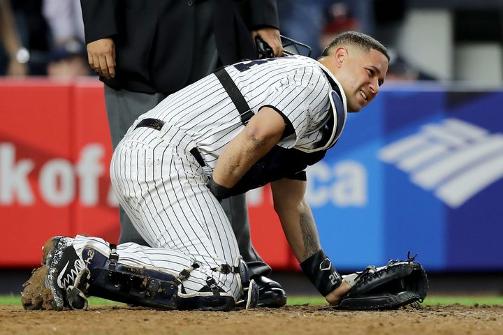 New York Yankees catcher Gary Sanchezdoubles over in pain after taking a foul ball to his privates during a game agains