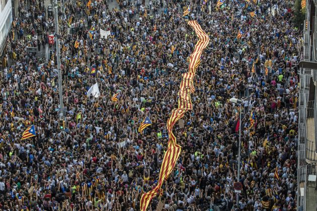 Tens of thousands of demonstrators took to the streets in Barcelona to protest against alleged police...