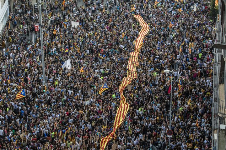 Tens of thousands of demonstrators took to the streets in Barcelona to protest against alleged police violence in Barcelona during the the Catalan independence referendum