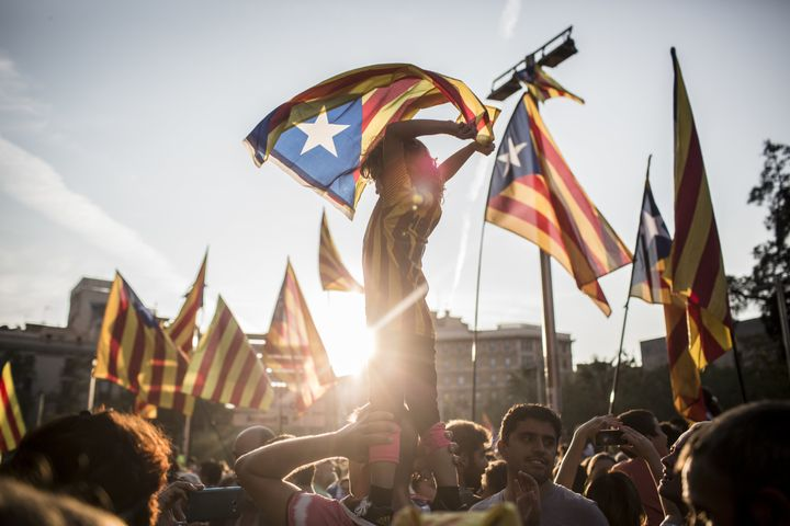 Demonstrators wave Catalan flags during the demonstration