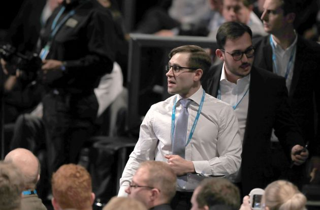 Comedian Simon Brodkin, also known as Lee Nelson is led out of the Conservative Party Conference