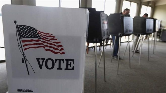 Voters cast their ballots in an Illinois primary. State election officials often come under fire for their handling of voter