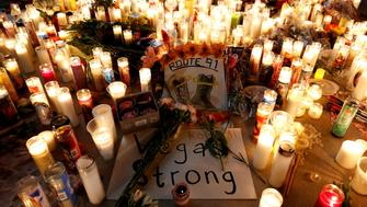 A candlelight vigil is pictured on the Las Vegas strip following a mass shooting at the Route 91 Harvest Country Music Festival in Las Vegas, Nevada, U.S., October 2, 2017. Picture taken October 2, 2017. REUTERS/Chris Wattie