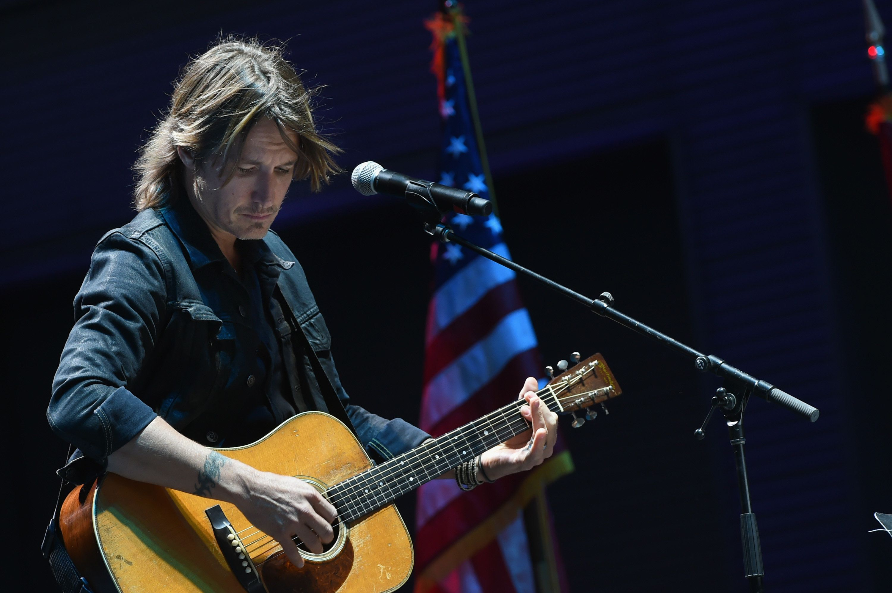 NASHVILLE, TN - OCTOBER 02:  Singer/Songwriter Keith Urban performs 'Bridge Over Troubled Water' during Nashville Candelight Vigil For Las Vegas at Ascend Amphitheater on October 2, 2017 in Nashville, Tennessee.  Late Sunday night, a lone gunman, Stephan Paddock, 64, of Mesquite, Nevada, opened fire on attendees at the Route 91 Harvest Festival, a three-day country music festival, leaving at least 59 dead and over 500 injured before killing himself.  The massacre is one of the deadliest mass shooting events in U.S. history.  (Photo by Rick Diamond/Getty Images)