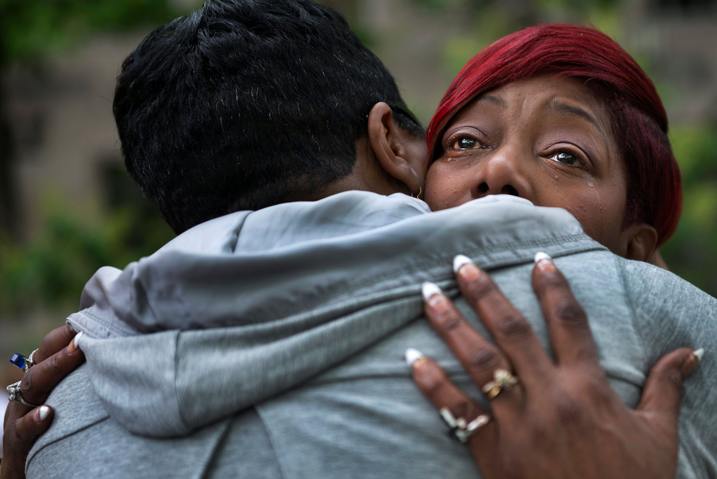 WASHINGTON, DC - MAY 9: Maria Hamilton, founder of Mothers For Justice United, cries as she gets a hug from Pastor Traci Blac