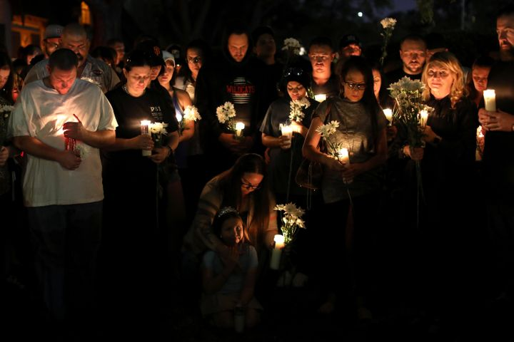 A candlelight vigil is held at Zack Bagans Haunted Museum in remembrance of victims following the mass shooting along the Las