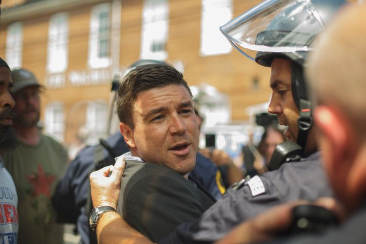 Jason Kessler is forcibly removed by Virginia state police during an attempted press conference in the wake of a deadly white