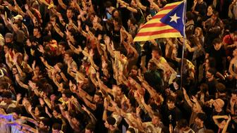 People raise arms and shout during a demonstration two days after the banned independence referendum in Barcelona, Spain, October 3, 2017. REUTERS/Susana Vera