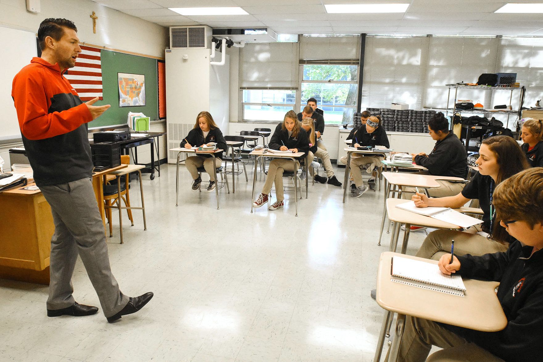 Jordan Miller teaches a junior English class at Bishop Luers High School in Fort Wayne.