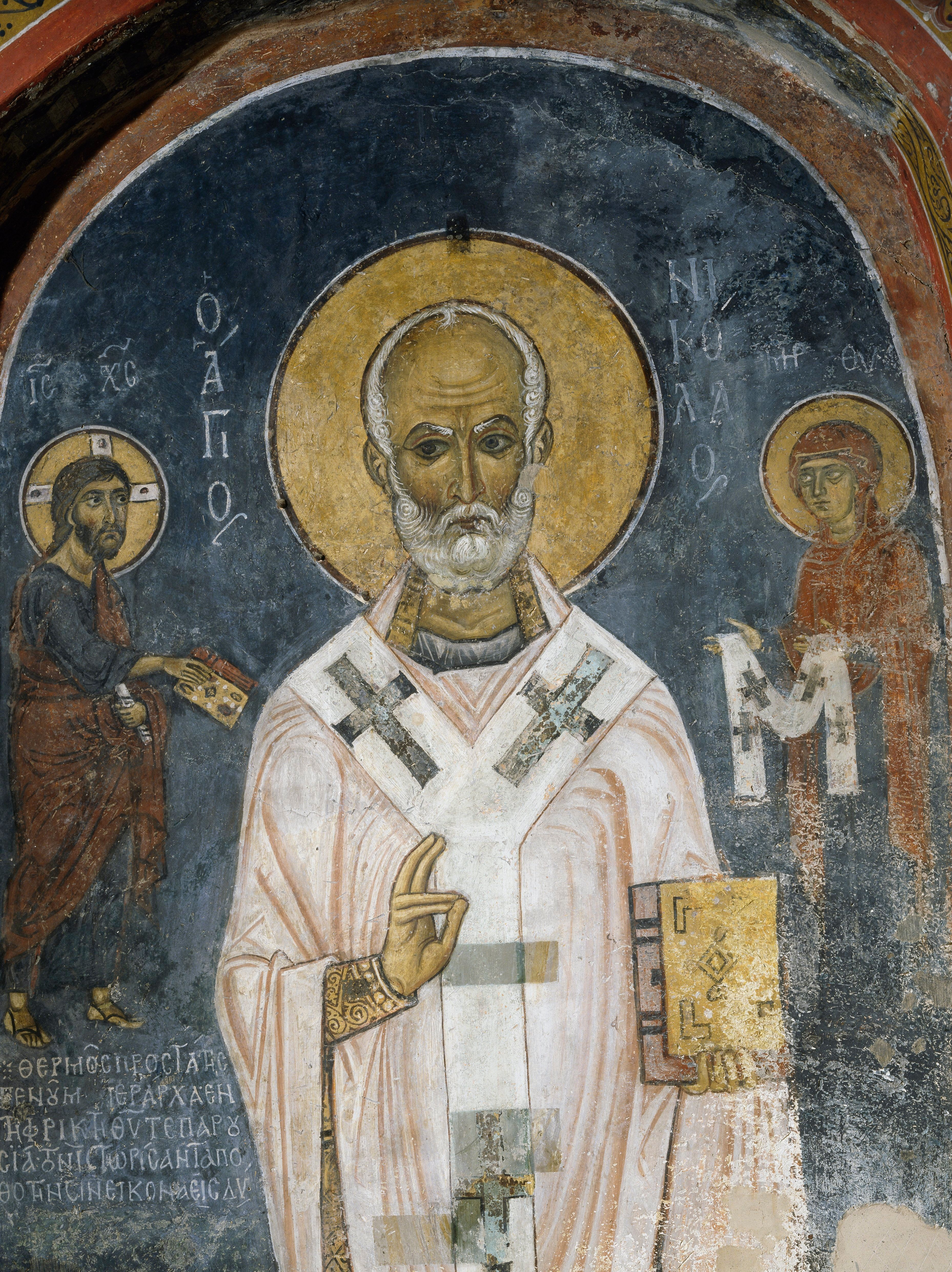 St. Nicholas of Myra is seen in this 12th-century fresco. The saint's acts of generosity, particularly to children, inspired