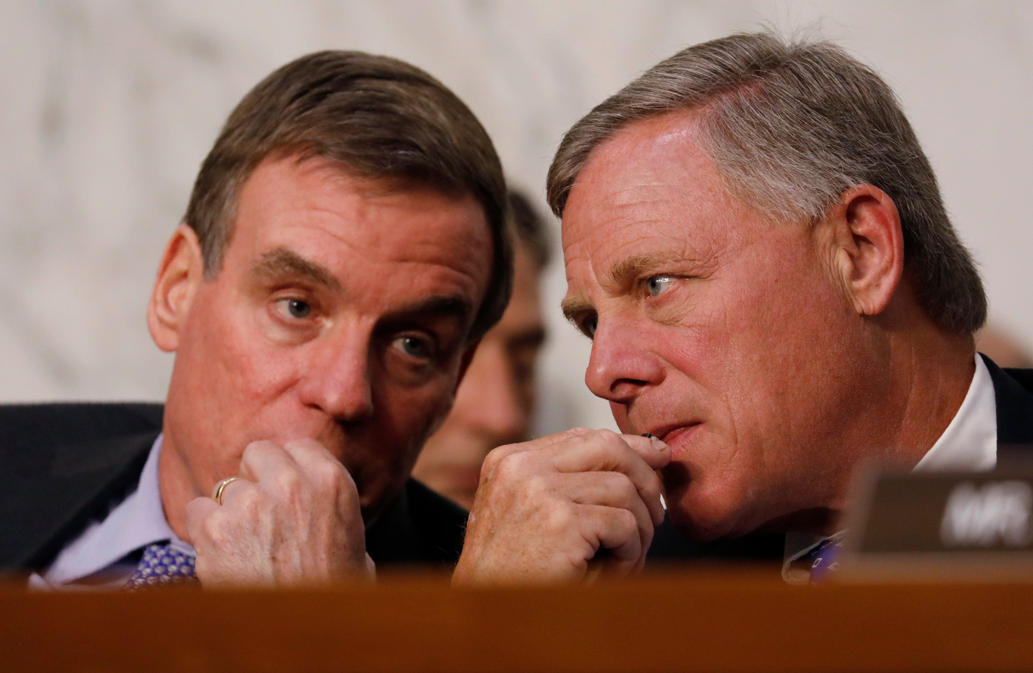 Senate Intelligence Committee vice chairman Sen. Mark Warner and chairman Sen. Richard Burr listen as U.S. Attorney General J