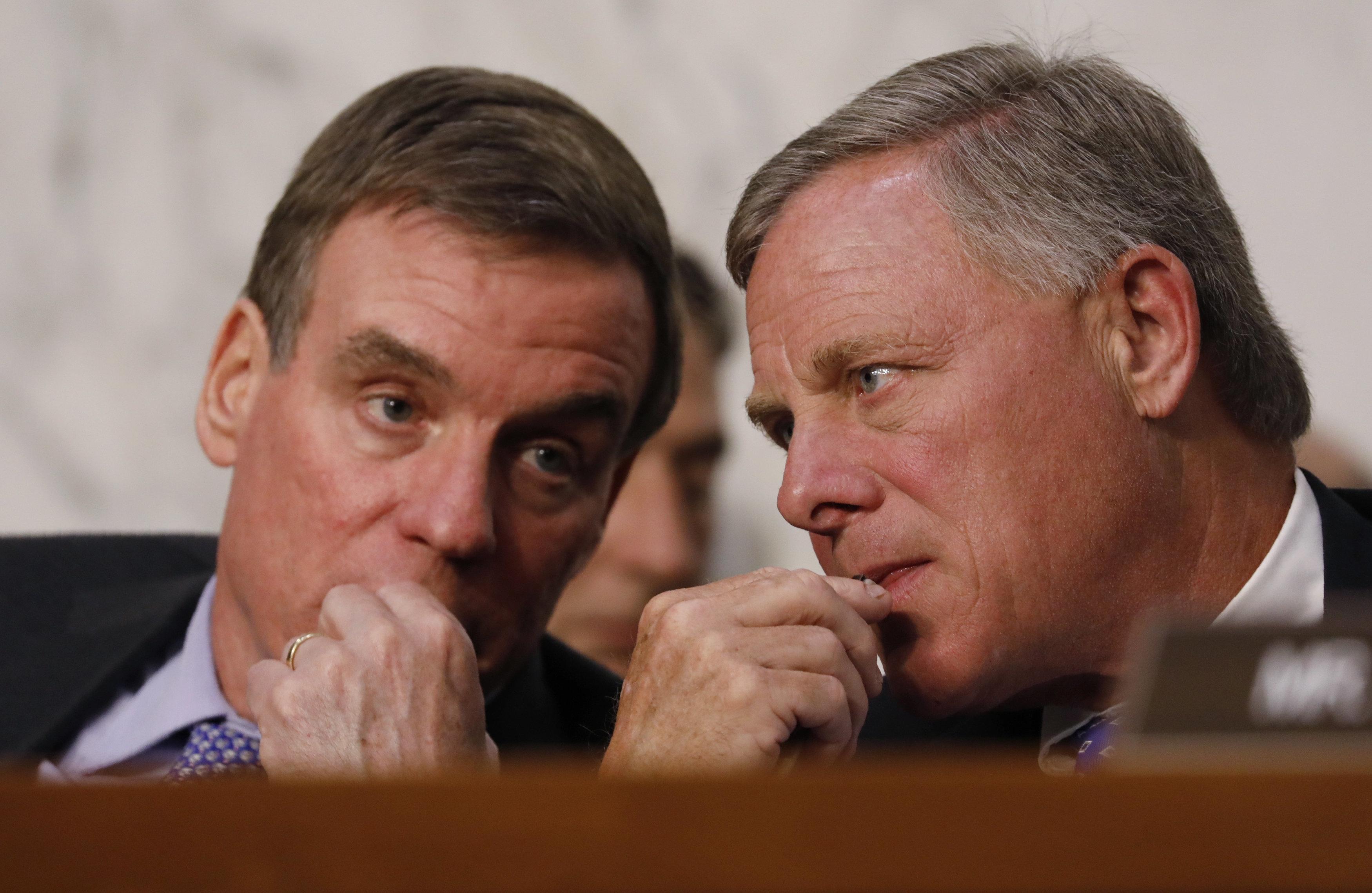 Senate Intelligence Committee vice chairman Sen. Mark Warner and chairman Sen. Richard Burr listen as U.S. Attorney General J