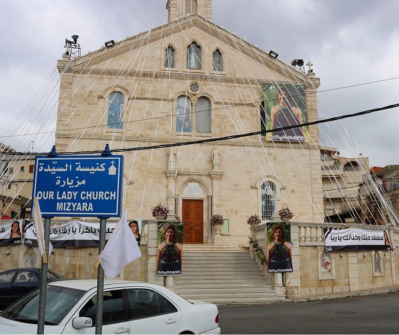 Photos of Raya Chidiac have been plastered across Miziara, a town in northern Lebanon, following her violent death.