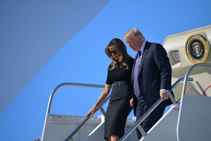 President Donald Trump and first lady Melania Trump step off Air Force One upon arrival at McCarran International Airport in
