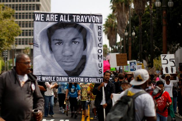 People carry a photo of Trayvon Martin during a march to protest the verdict in the George Zimmerman...