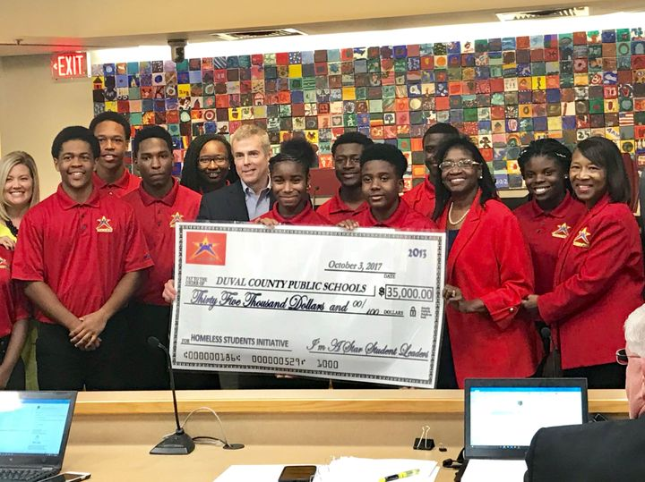 I'm A Star teens presenting a check to help Jacksonville's 2,700 homeless students.