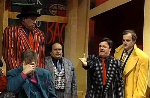 "Ernie Sabella (wearing the grey plaid jacket) & Nathan Lane (wearing the black striped jacket) in the 1992 revival of ""Gu"