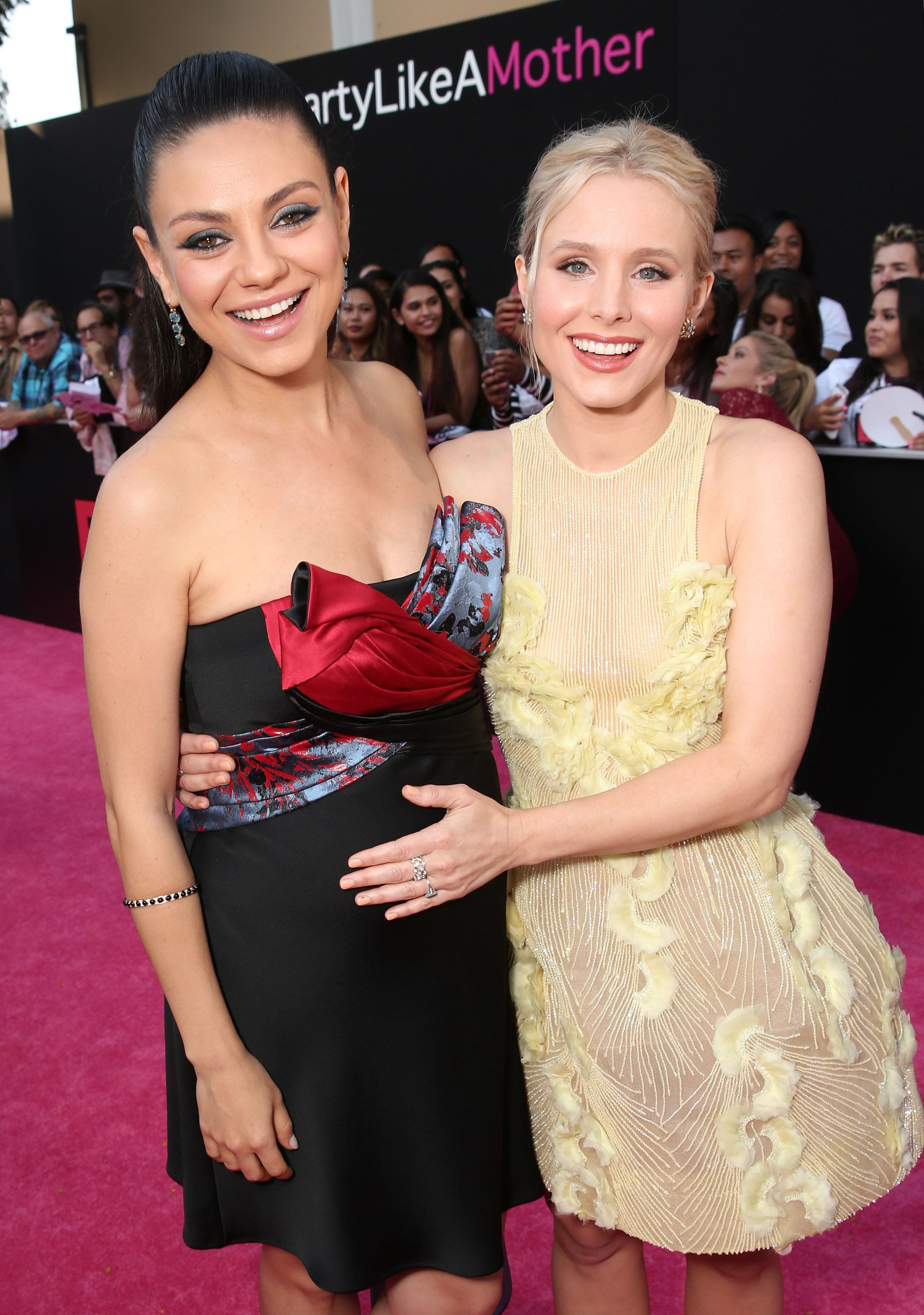 WESTWOOD, CA - JULY 26:  Mila Kunis and Kristen Bell attend the premiere Of STX Entertainment's 'Bad Moms' at Mann Village Theatre on July 26, 2016 in Westwood, California.  (Photo by Todd Williamson/Getty Images)