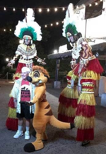 "Ernie Sabella poses with WDW cast members after a recent performance of the  ""Festival of the Lion King"" stage show."