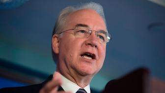 US Secretary of Health and Human Services Tom Price attends a press conference about influenza prevention for the upcoming flu season at the National Press Club in Washington, DC, September 28, 2017. Five Democratic lawmakers have called for the resignation of Health and Human Services Secretary Tom Price for what they described as 'a gross misuse of public funds,' notably for spending $25,000 on a private roundtrip flight from Washington to nearby Philadelphia. / AFP PHOTO / SAUL LOEB        (Photo credit should read SAUL LOEB/AFP/Getty Images)
