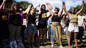 Protesters listen to speeches as they arrive at Lincoln Park to take part in a march for Racial Justice in Washington, DC, on September 30, 2017.  / AFP PHOTO / ERIC BARADAT        (Photo credit should read ERIC BARADAT/AFP/Getty Images)
